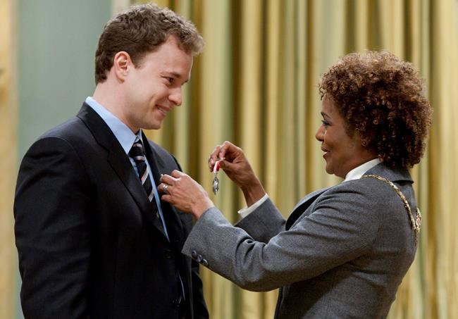 """Marc Kielburger from Toronto receives the Order of Canada from Governor General Michaelle Jean during a ceremony at Rideau Hall in Ottawa on Wednesday April 7, 2010. One of the co-founders of WE Charity says he """"misspoke"""" when he told youth leaders earlier this month that Prime Minister Justin Trudeau's staff reached out in April to see if the organization would administer a $900-million federal student-aid program.THE CANADIAN PRESS/Sean Kilpatrick"""