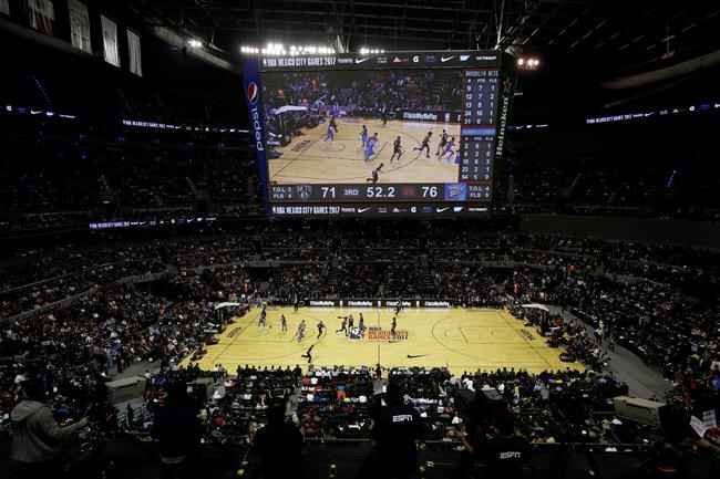 Basketball fans watch the second half of a regular-season NBA basketball game between the Brooklyn Nets and Oklahoma City Thunder in Mexico City Thursday Dec. 7 2017. The Brooklyn Nets will also take on the Miami Heat Saturday in their second regular-s