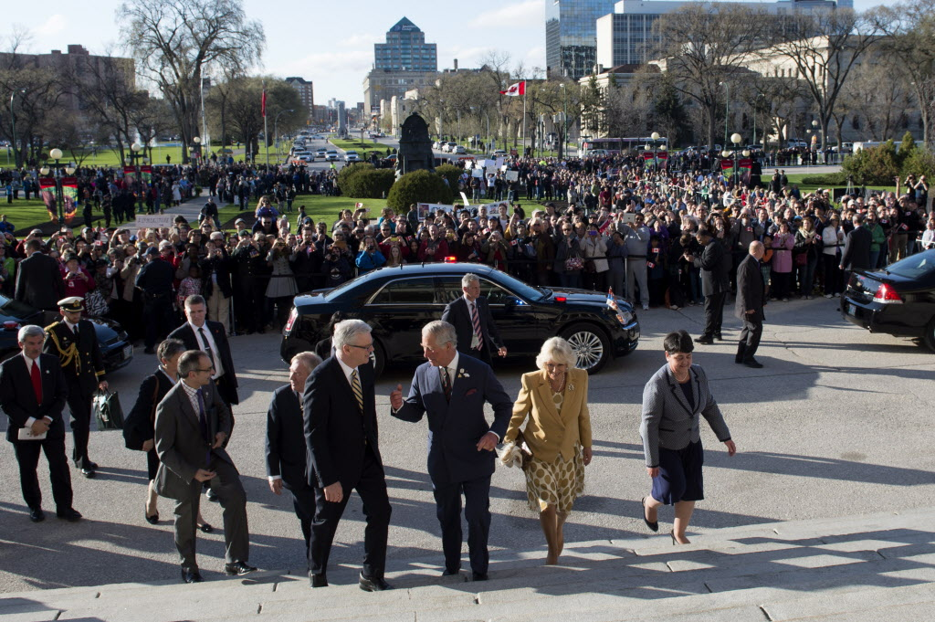 Prince Charles and his wife Camilla arrive at the Manitoba Legislature for the Order of Manitoba ceremony Wednesday.  (Paul Chiasson / The Canadian Press )