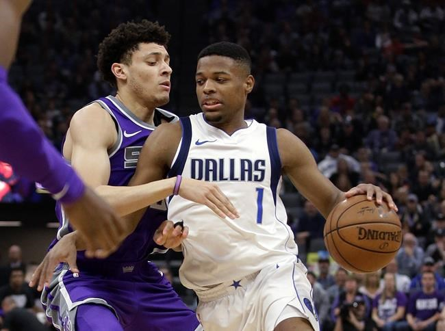 Mavericks use big run in fourth quarter to rally past Kings