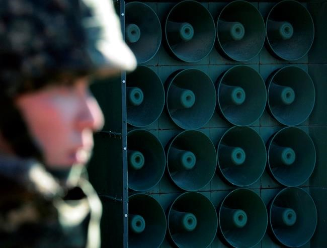 FILE - In this Friday, Jan. 8, 2016 file photo, a South Korean army soldier stands near the loudspeakers near the border area between South Korea and North Korea in Yeoncheon, South Korea. South Korea on Monday, April 30, 2018, said it will remove propaganda-broadcasting loudspeakers from the tense border with North Korea. The announcement came three days after the leaders of the two Koreas agreed to work together to achieve a nuclear-free Korean Peninsula and end hostile acts against each other along their border during their rare summit talks. (Lim Tae-hoon/Newsis via AP, File)