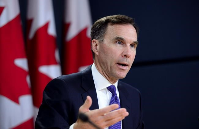 Finance Minister Bill Morneau speaks at the National Press Theatre during a press conference in Ottawa on Tuesday, May 29, 2018. The federal Liberal government is spending $4.5 billion to buy Trans Mountain and all of Kinder Morgan Canada's core assets, Finance Minister Bill Morneau said Tuesday as he unveiled the government's long-awaited, big-budget strategy to save the plan to expand the oilsands pipeline. THE CANADIAN PRESS/Sean Kilpatrick