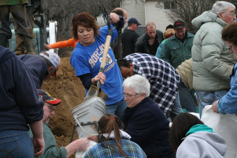With their town's sewage treatment plant at risk Souris and district residents were feverishly filling sandbags the old fashioned way - by hand - Saturday afternoon in the arena parking lot.