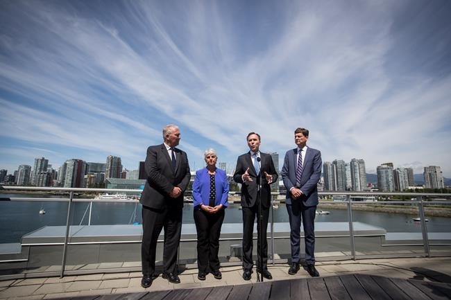 Federal Minister of Finance Bill Morneau, third left, speaks as Federal Minister of Border Security and Organized Crime Reduction Bill Blair, from left to right, B.C. Finance Minister Carole James and B.C. Attorney General David Eby listen during a news conference after attending a meeting about money laundering and terrorist financing, in Vancouver, on Thursday June 13, 2019. THE CANADIAN PRESS/Darryl Dyck