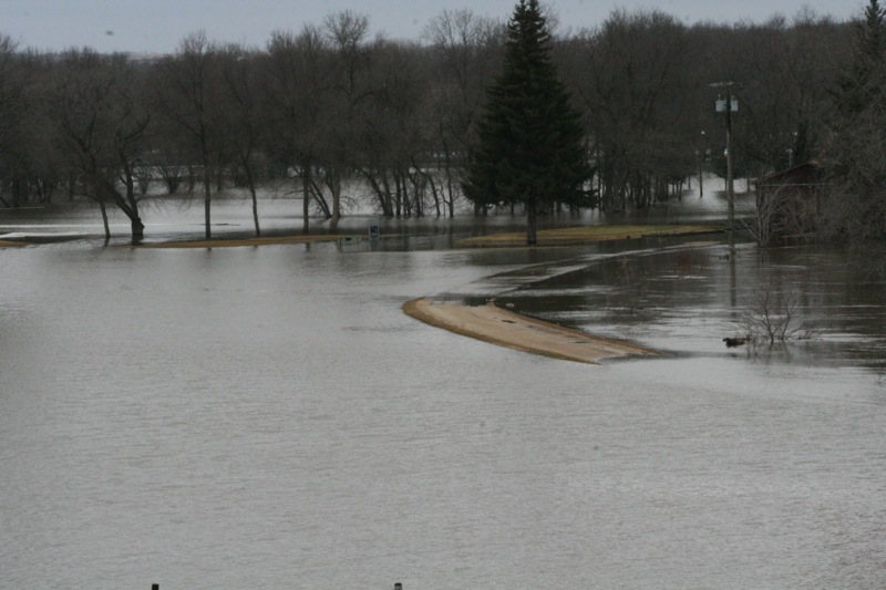 No need to book a tee-time at Brandon's Wheat City Golf Course in the near future. The rising Assiniboine River, which has yet to crest,  has breached the dike protecting the course along the first hole. (Ewan Pow / Brandon Sun)