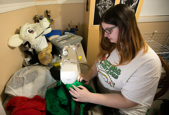 Onix Collette, local fur suit designer, adds some final touches to a custom fur suit on Nov. 14.