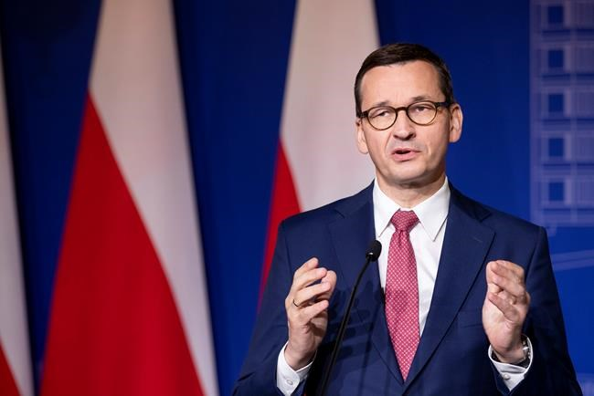 Poland's Prime Minister Mateusz Morawiecki speaks during a news conference following joint meetings of the government of the Lithuania and the government of the Poland at the Palace of the Grand Dukes of Lithuania in Vilnius, Lithuania, Thursday, Sept. 17, 2020. (AP Photo/Mindaugas Kulbis)