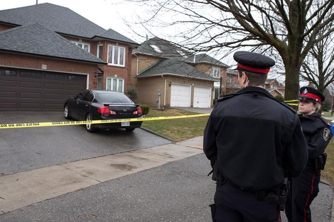 Police maintain a presence outside the house where Alek Minassian lived in Richmond Hill, Ont., just north of Toronto, on Wednesday, April 25, 2018. Minassian is facing multiple charges relating to the deaths of 10 people after a van struck pedestrians along Yonge Street in Toronto on Monday. THE CANADIAN PRESS/Chris Young