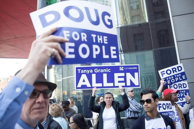 Ontario PC supporters, including those protesting against the ejection of candidate Tanya Granic Allen from the PC list of candidates, gather ahead of the first televised Leaders Debate, in Toronto on Monday May 7, 2018. THE CANADIAN PRESS/Chris Young