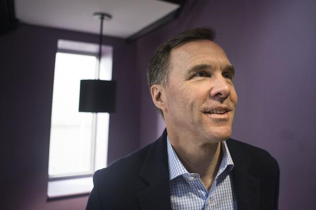 Federal Finance Minister Bill Morneau arrives for a pre-budget photo opportunity in Toronto on Thursday, March 14, 2019. THE CANADIAN PRESS/Chris Young