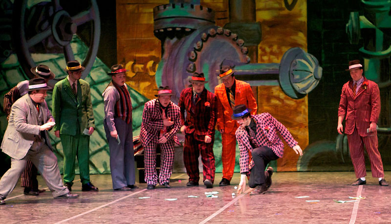 """Gamblers roll the dice in the sewer scene from 7 Ages' """"Guys and Dolls."""" From left:  Jeremy Lancaster, Andrew Mok (hidden), Dylan Keogh, Clint McLaughlan, Eric Bussell, Travis Oliver, Sean Keogh, Randy Lilley and Cam Tataryn. The musical opens tonight at the Western Manitoba Centennial Auditorium."""