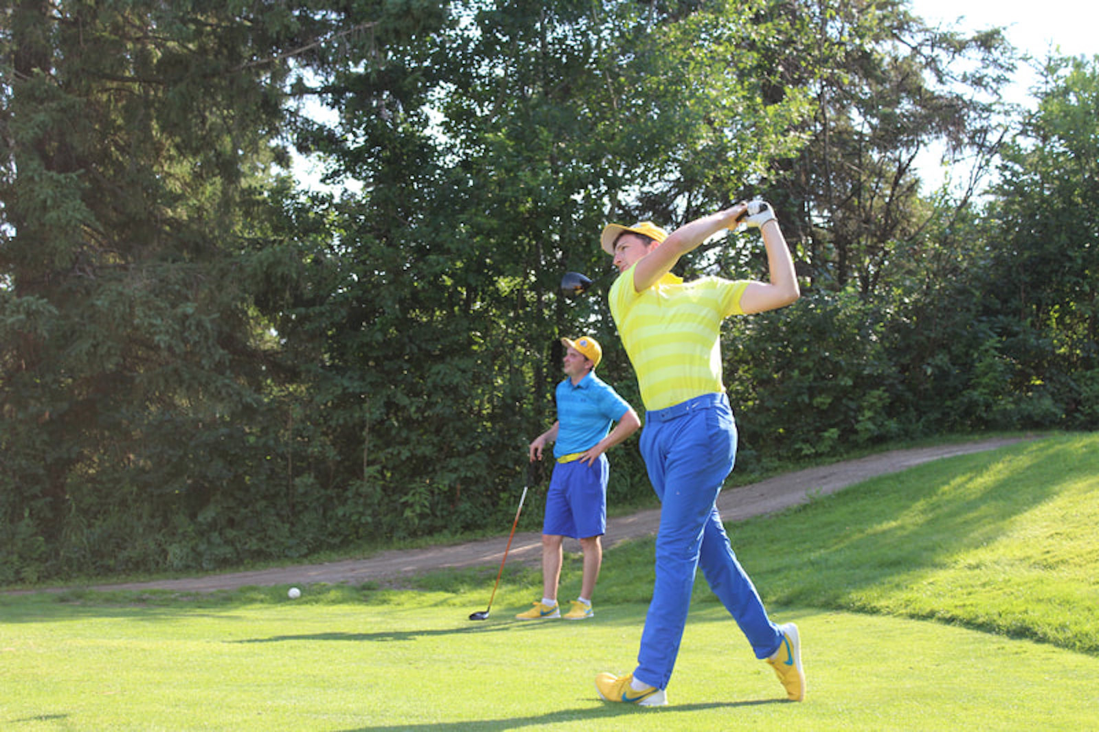 Dylan Thornborough hits a shot while Patrick Law looks on during a past Marathon Monday at Glenboro Golf and Country Club. The event raises money for the Canadian Cancer Society and is set for July 26 this year.