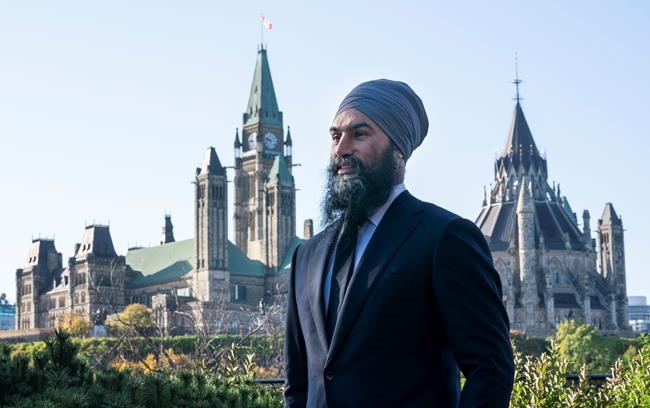 NDP Leader Jagmeet Singh is pictured with Parliament Hill in the background in Ottawa on Thursday, October 10, 2019. THE CANADIAN PRESS/Paul Chiasson