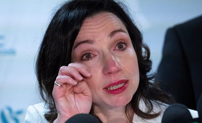 Martine Ouellet wipes a tear during a news conference in Montreal on Monday, June 4, 2018. Ouellet announced she is stepping down as head of the Bloc Quebecois after a resounding defeat in a weekend leadership vote. THE CANADIAN PRESS/Paul Chiasson
