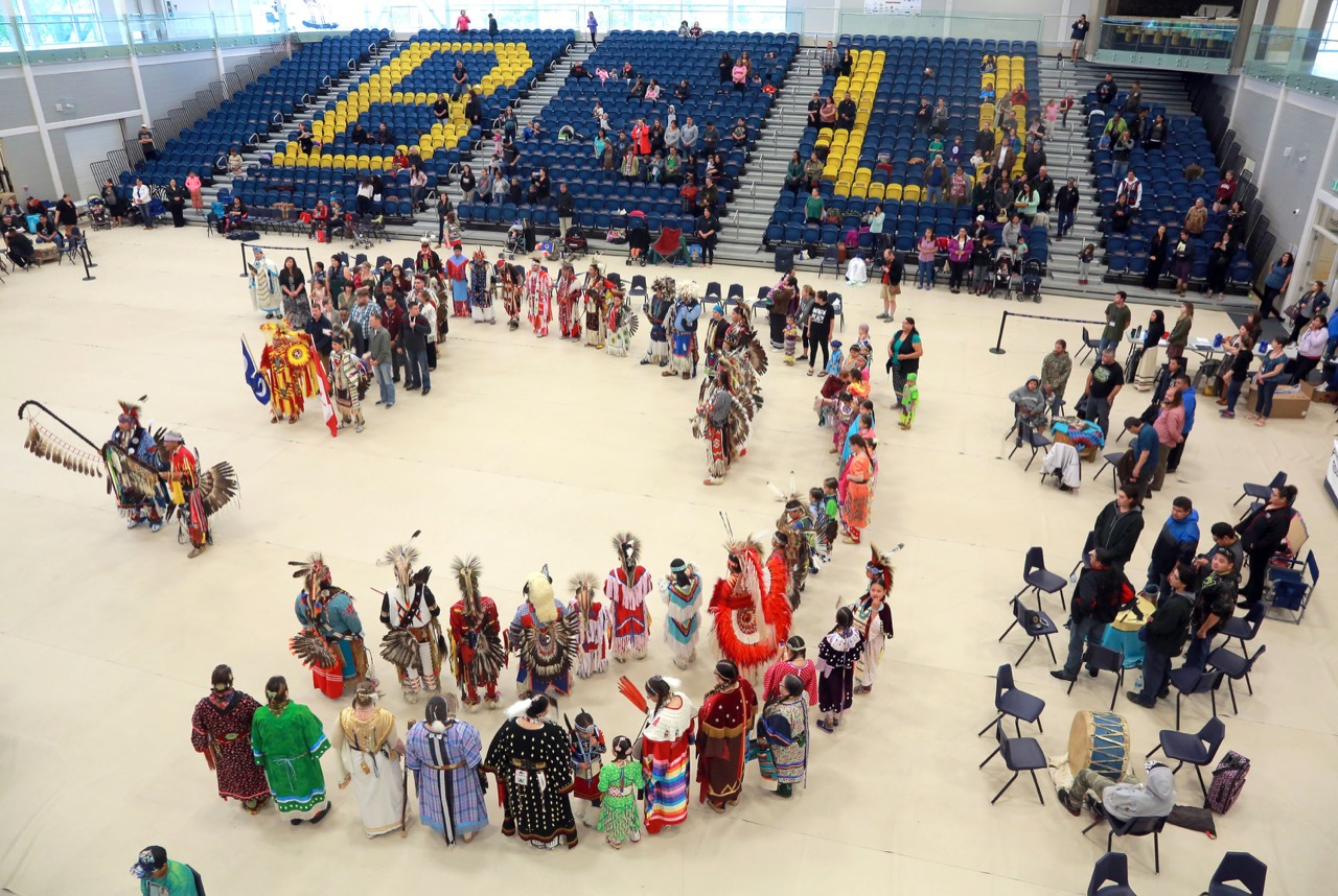 Dancers and other dignitaries file into the Healthy Living Centre for the Grand Entry to start an All Nations Powwow, Saturday afternoon at Brandon University. The celebration started in 2010 and honours indigenous, Métis and Inuit graduates, with approximately 30 of the dancers being new diploma holders.