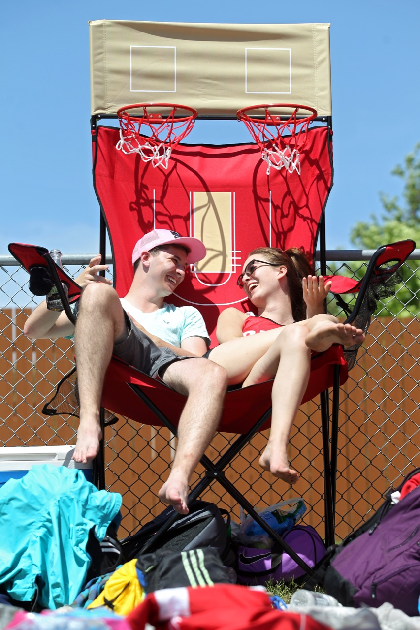 Domanick Pennell and Aubrey Queen of R.D. Parker Collegiate relax in a giant lawn chair on the opening day of the Provincial Track and Field Championships at the UCT Stadium on a scorching hot Thursday afternoon. (Tim Smith / Brandon Sun)