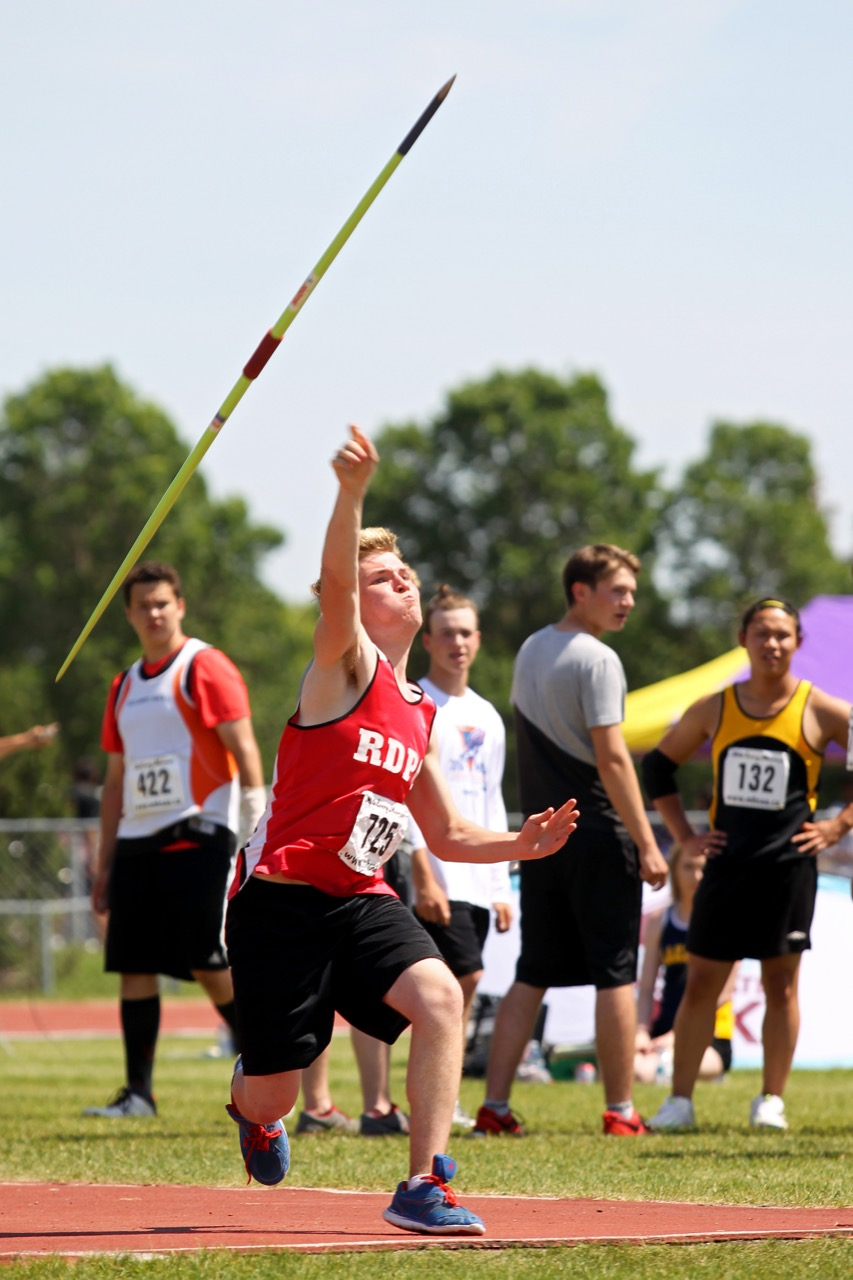 High School boys compete in the javelin event on the opening day of the Provincial Track and Field Championships at the UCT Stadium on a scorching hot Thursday afternoon. (Tim Smith / Brandon Sun)