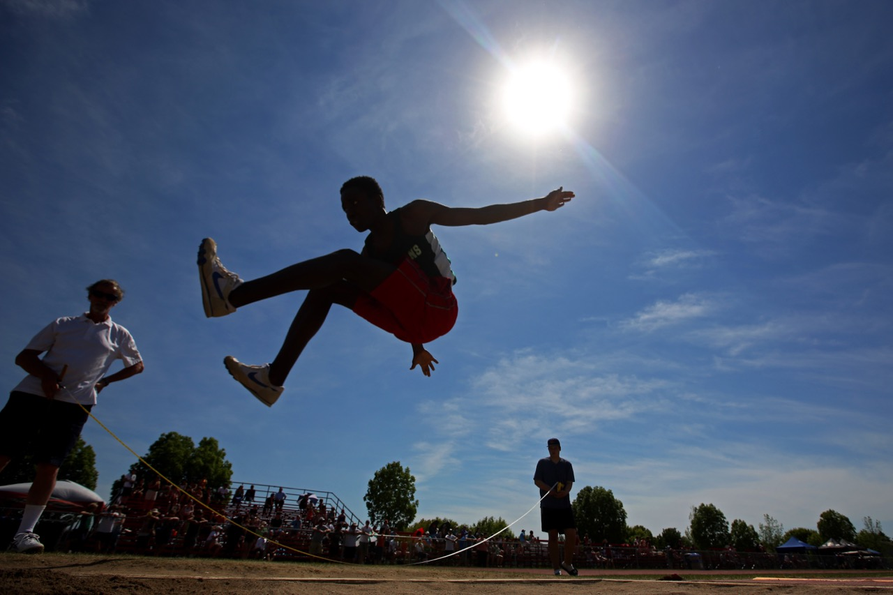 A competitor leaps through the air while competing in the Junior Varsity Boys Long Jump event on the opening day of the Provincial Track and Field Championships at the UCT Stadium on a scorching hot Thursday afternoon. (Tim Smith / Brandon Sun)