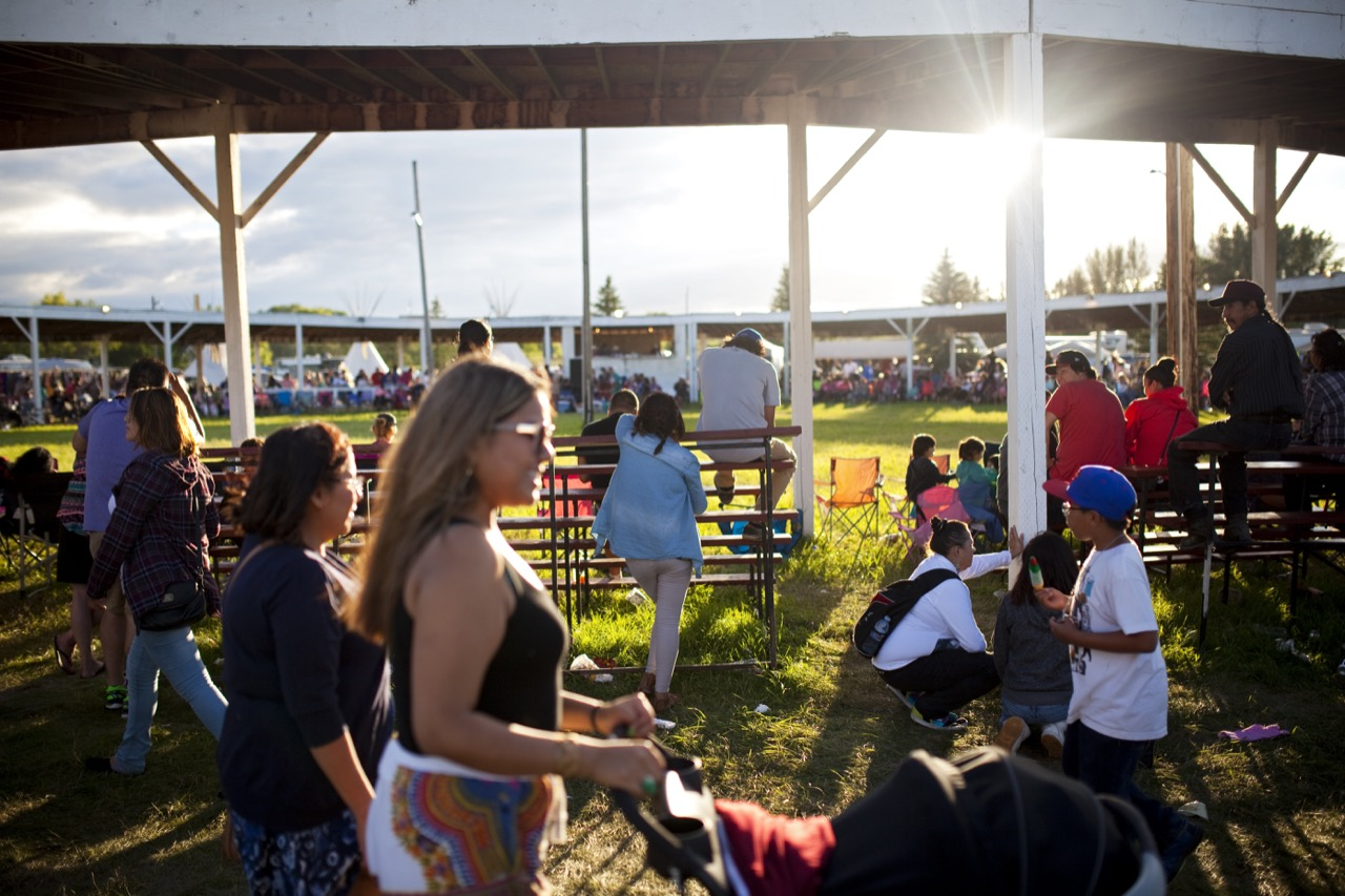 Visitors to the 2016 Sioux Valley Dakota Nation Pow wow wander the grounds outside the pow wow arena on Saturday evening. Competitors and visitors from throughout North America came to Sioux Valley for the three day pow wow. (Tim Smith / Brandon Sun)