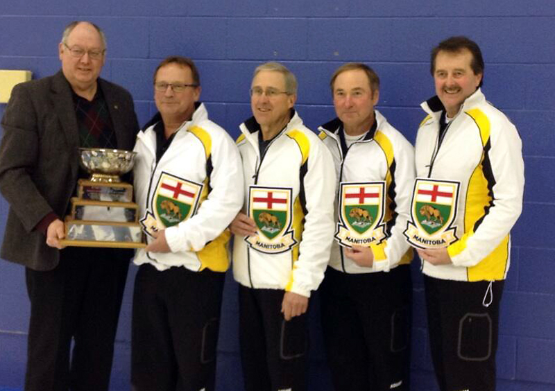 CurlManitoba's Resby Coutts presents the provincial senior men's trophy to (left to right) Kelly Robertson, Doug Armour, Peter Prokopowich and Bob Scales on Monday.