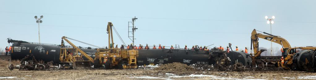 Workers clear the CN Rail line of debris following a derailment east of Brandon on Wednesday evening. No one was injured in the crash.